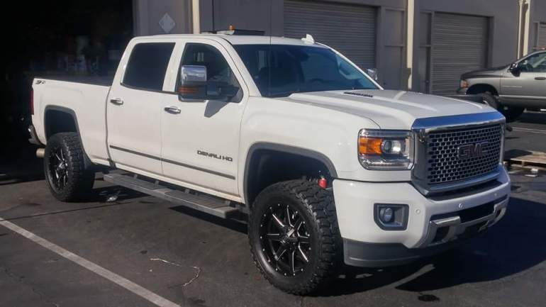 "2015 GMC Denali 2500 HD, 3"" Level kit, 305/55R20 Mickey Thompson ATZ Tires(33"" Tall) 20X9 Fuel Maverick Rims"