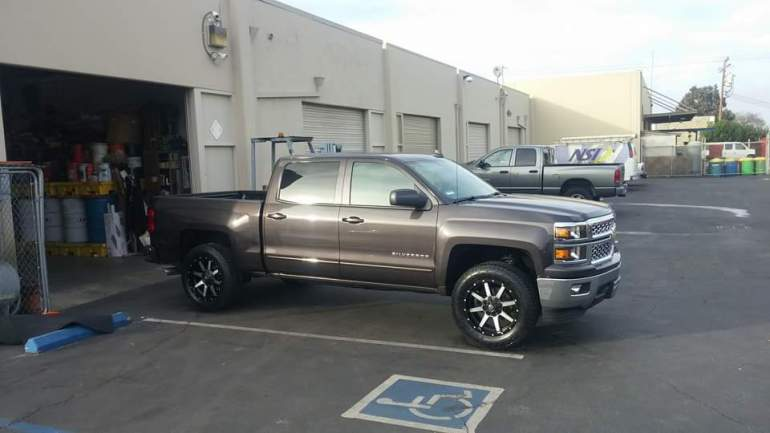 "2015 Chevy 1500 2.25 leveling kit, 275/60R20 Toyo Open Country AT II Tires(33"" Tall), 20X9 Fuel Maverick w/Polished Face"
