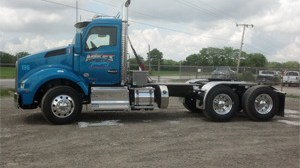 Equipment - Kenworth Strong Arm Dump Trucks