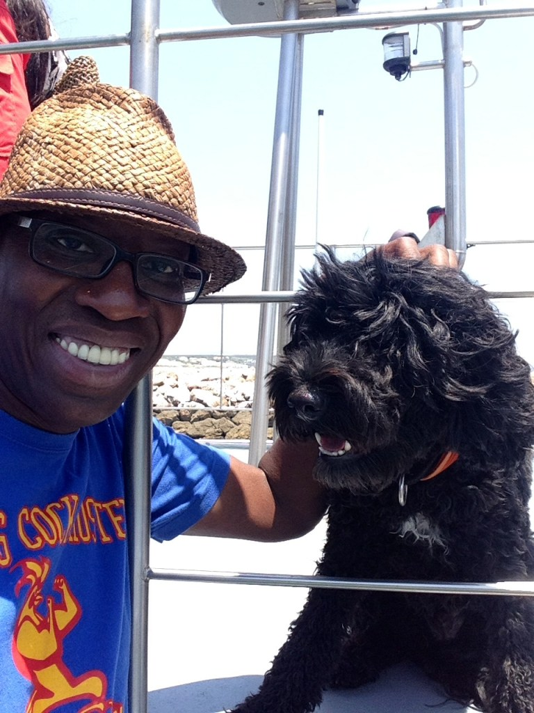 With Zuka, the dolphin-spotting Portuguese water dog, aboard the Days Of Adventure