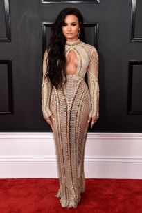Demi Lovato in an aztec inspired beaded one piece gown, complimented with matching jewels and striking black hair - Photo Credit: John Shearer / WireImages (All Rights Reserved)