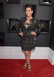 """Kris Jenner in a gothic floral short dress with a """"matching"""" """"sensible"""" heel, complimented with subtle silver jewellery - Photo Credit: Lester Cohen / Getty Images (All Rights Reserved)"""