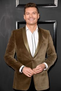 Ryan Seacrest in a light-brown velvet suit with a white shirt for added emphasis - Photo Credit: Frazer Harrison / Getty Images (All Rights Reserved)