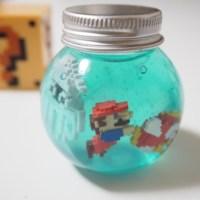 毎日暑いので、ガチャガチャ「金魚マイボトルスライミー」を使って小さなマリオ水槽を作ってみた