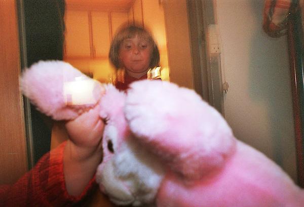 Suburbia - child and teddybear.