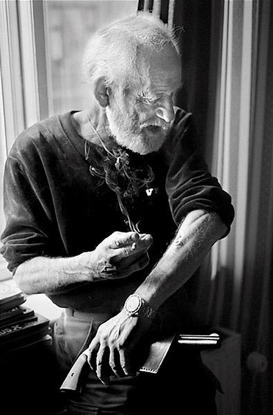 old guy gun tattoo