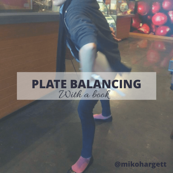 Plate balancing with a book