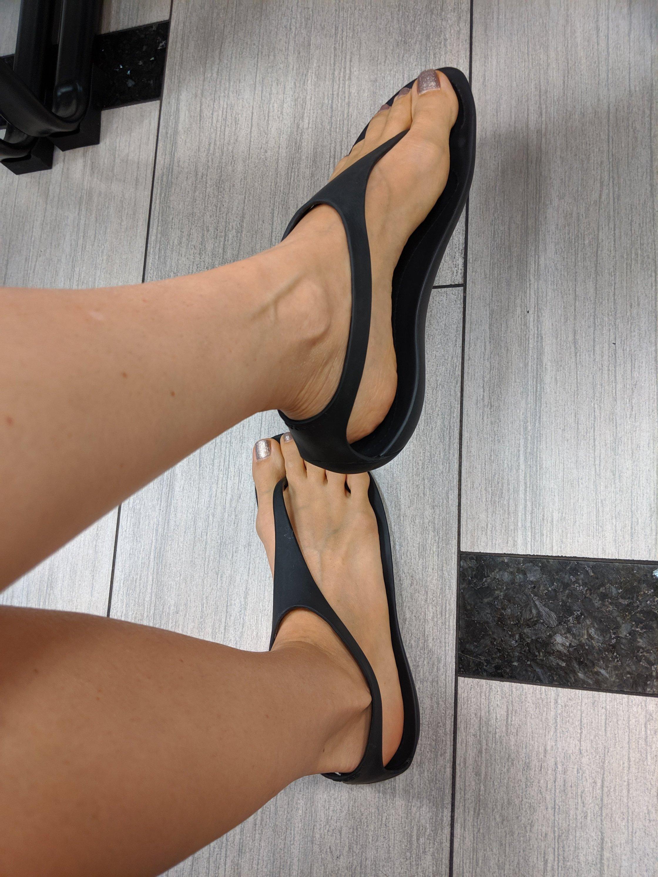 woman's feet in crocs