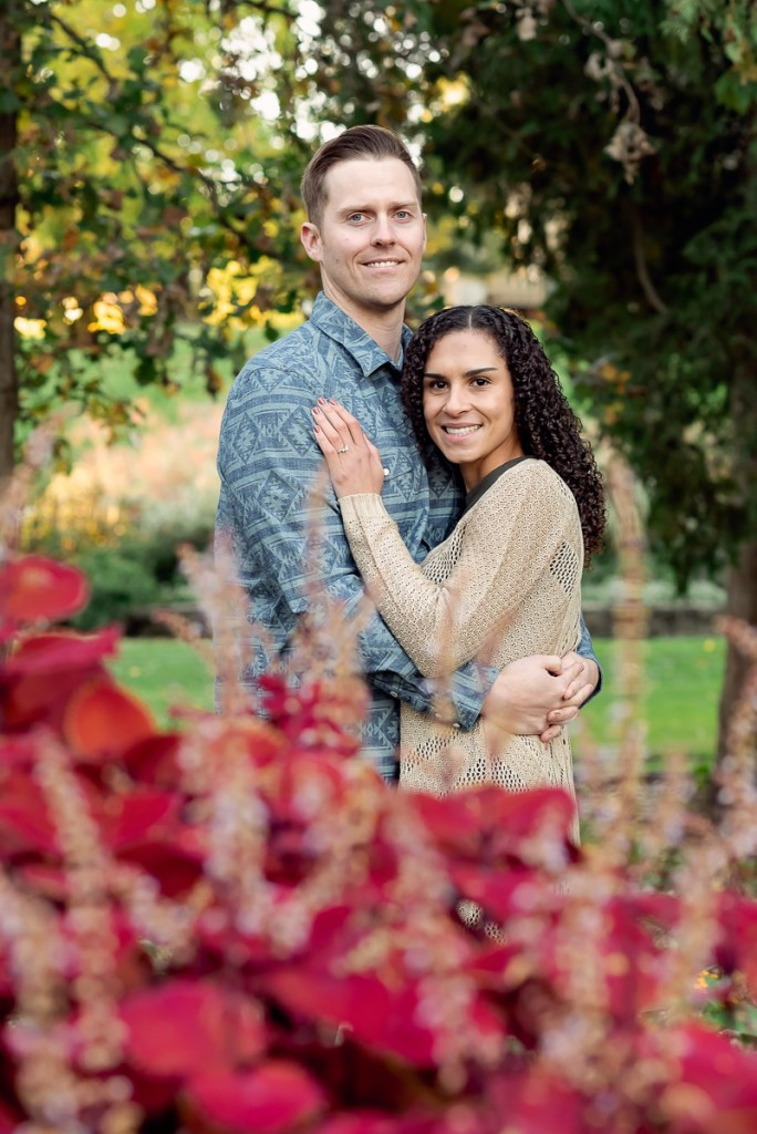 An engagement session for an engaged couple at Fabyan Forest Preserve in the fall by a wedding photographer Mila Craila Photography
