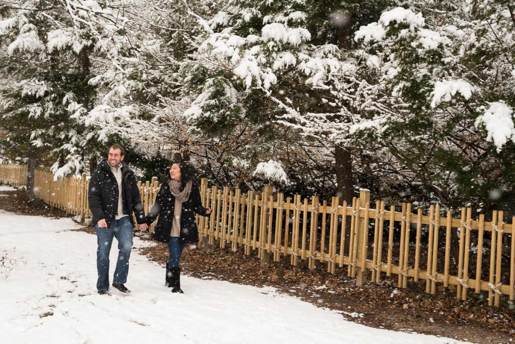 An engagement session for an engaged couple walking at Fabyan Forest Preserve in the winter by a wedding photographer Mila Craila Photography