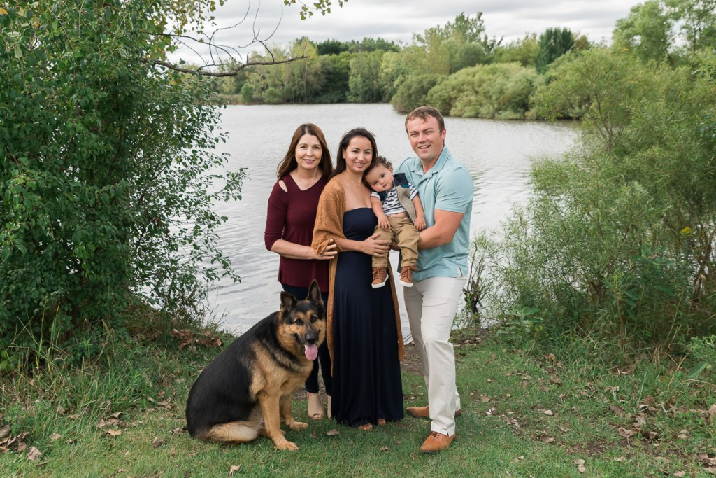 Family session for parents and a toddler son and a dog at SongBird Slough Forest Preserve in Itasca by family photographer Mila Craila Photography