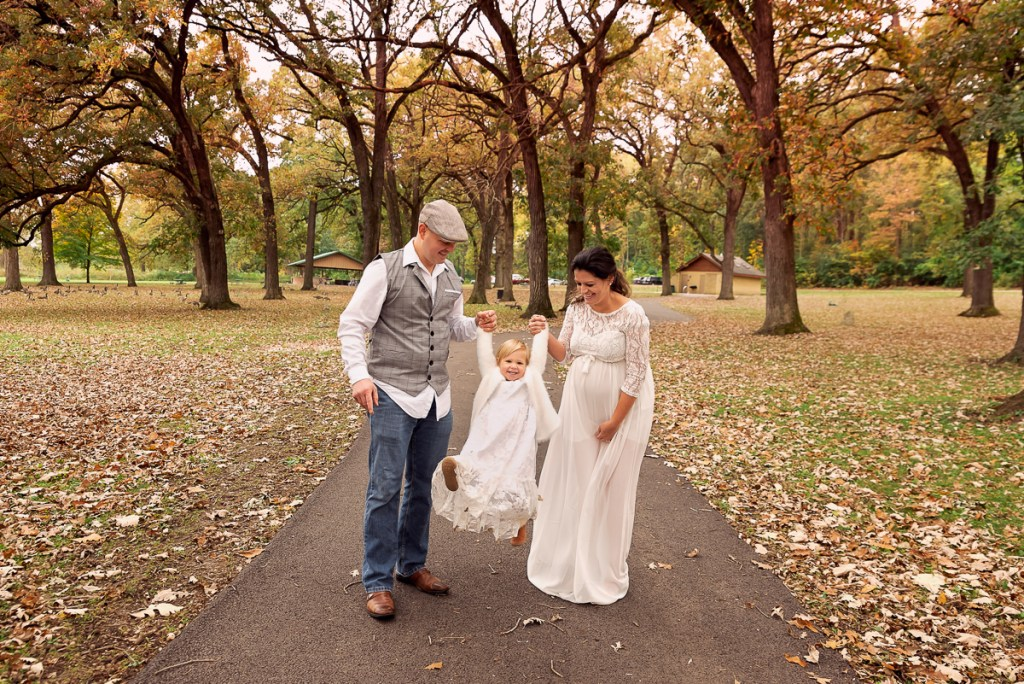 Family session for pregnant parents and a toddler daughter at Fabyan Forest Preserve in Geneva by family photographer Mila Craila Photography