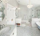 The combination of elegant mirror, chandelier and the white marble counter top, white flooring, and white marble cladding