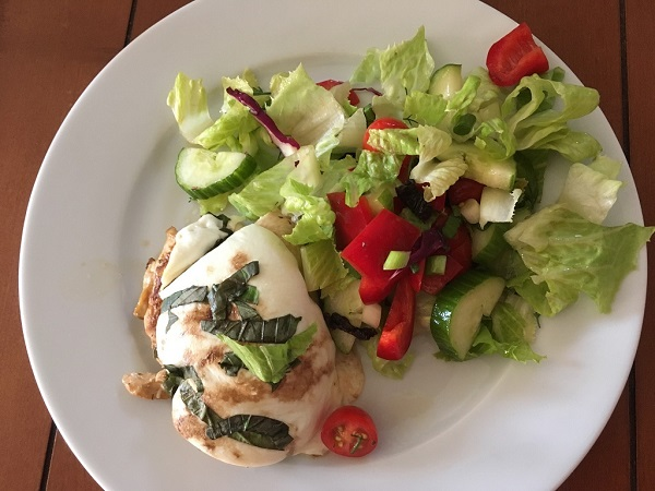 Chicken caprese with salad