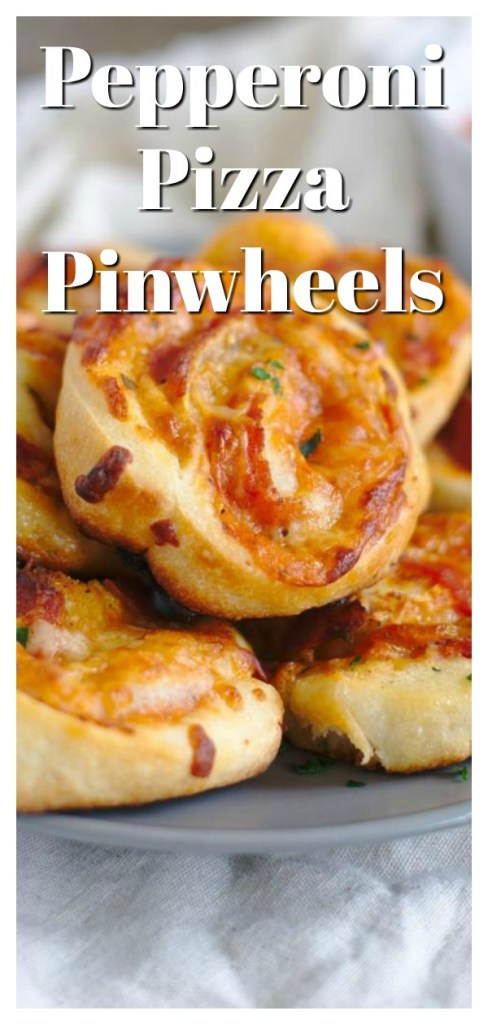 Pizza Pinwheels - A quick and easy appetizer! Pizza dough filled with marinara sauce, mozzarella, parmesan, and pepperoni and baked until golden brown. The ultimate pinwheel recipe! Pizza Appetizer | Pinwheel Recipe | Pepperoni Pizza Recipe