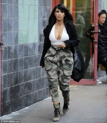 KIM KARDASHIAN EXPOSES HER CLEAVAGE AGAIN!...IS SHE A TREND-SETTER OR A FASHION VICTIM?