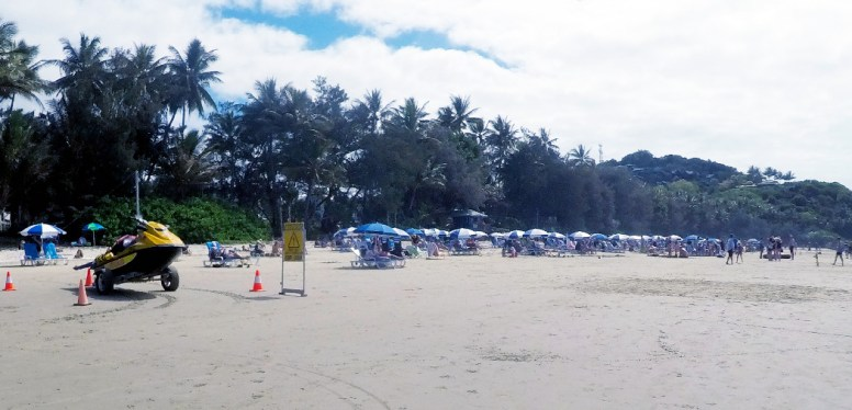 There is four miles of beach people so why do you have to all crowd here
