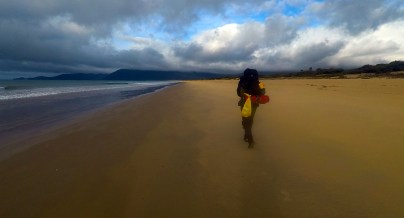 Matt hauling pack along 5 Mile Beach