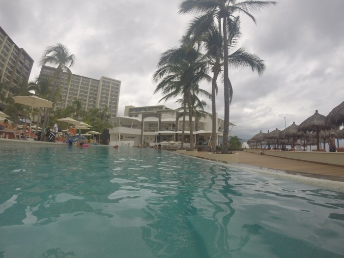 The infinity pool with swim-up bar