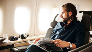 general image - man sitting in LH first cls