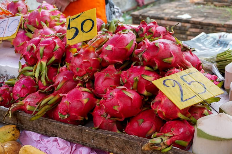 Pile of pink dragon fruit in a basket