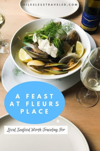 Bowl of seafood and wine empty plates at Fleurs Place New Zealand