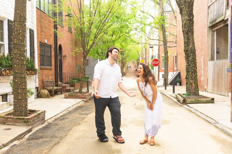 Couple laughing in street