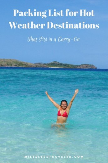 Woman in Blue Ocean with arms out of water in pink bikini text overlay Packing List for Hot Weather Destinations