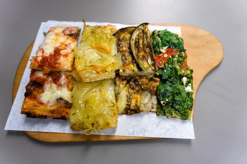 4 different types of Roman style pizza on a plate