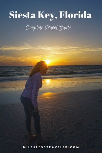 Girl on beach at sunset with text overlay Siesta Key Florida Complete Travel Guide mileslesstraveled.com