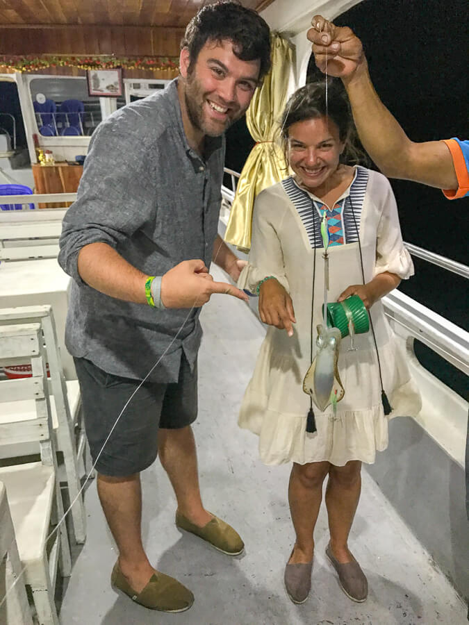 Man and Woman Squid fishing