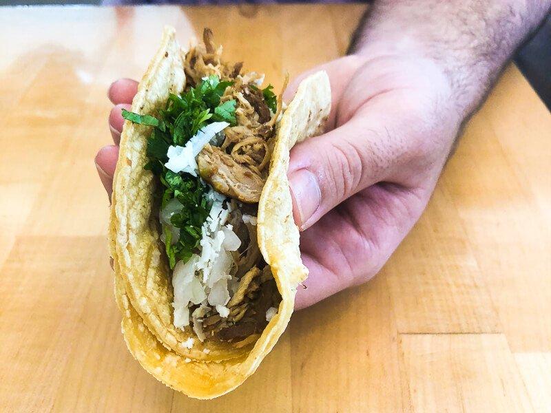 Man holding Torchy's taco Austin