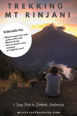 Girl back facing with sunset over Rinjani text overlay trekking MT\t. Rinjani