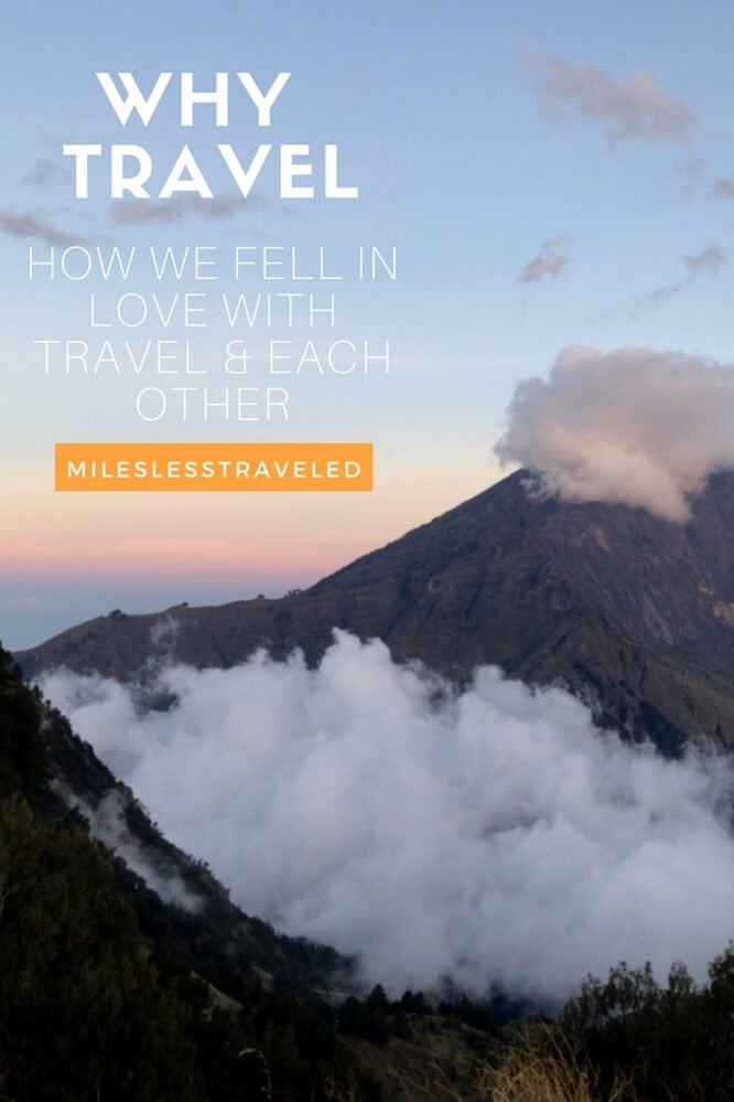 Mountain Sunset with cloud coverage text overlay why travel how we fell in love with travel & each other