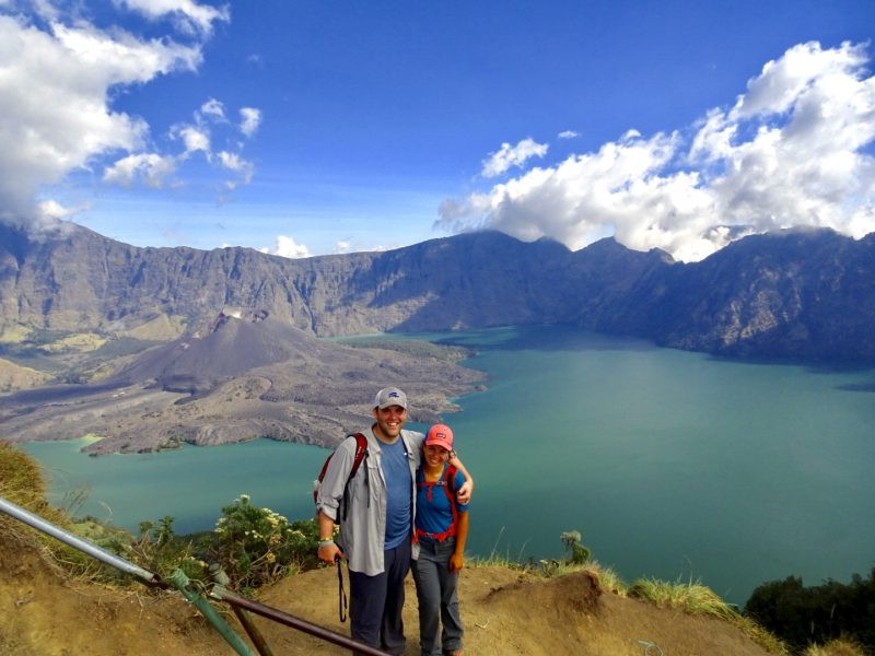 Couple standing at craterim after trekking Mt. Rinjani