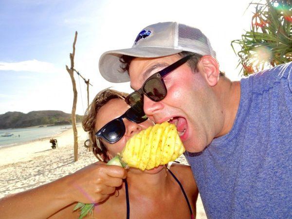 Eating pineapples on the beach in Kuta Lombok