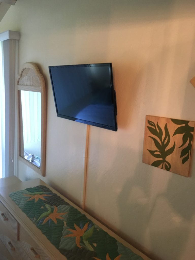The mounted TV in the master bedroom