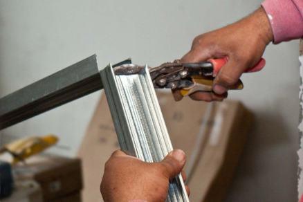 Drywall stud being cut