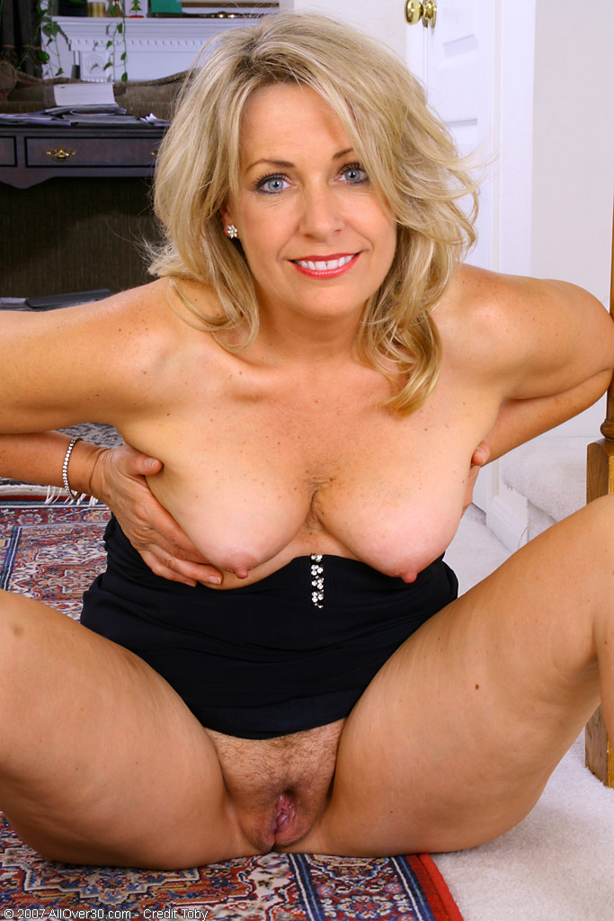 Busty blonde woman works hard on his cock 7