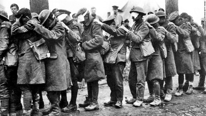 UNSPECIFIED -  : World War I 1914-1918: The blind leading the blind. Men of the 55th British Division, casualties of a poison gas attack walking in single file with hand on shoulder of man in front, 10 April 1918. Chemical Warfare Military Soldier (Photo by Universal History Archive/Getty Images)