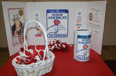 Table with baset and sign saying Honor America's Veterans