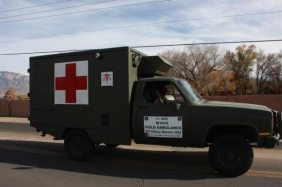 Military truck with red cross in parade
