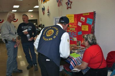 Veteran looking at Museum table