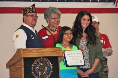 Veteran and family with plaque