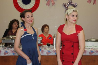 Two girls in red and blue dresses