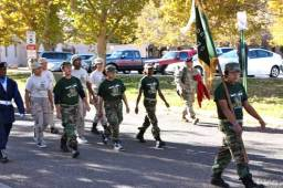 Kids in T-shirts and camo in parade