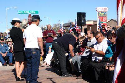 People addressing crowd
