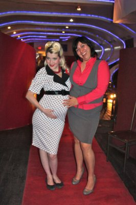 Woman in polka dot dress with woman in gray jumper
