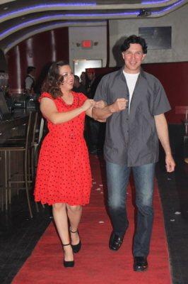 Femal model in red polka dot dress with man