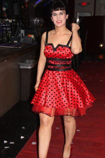 Model in red polka dot dress